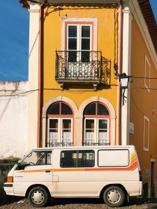 Coimbra building and van