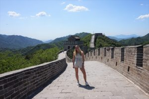 Riley standing on the Great Wall of China
