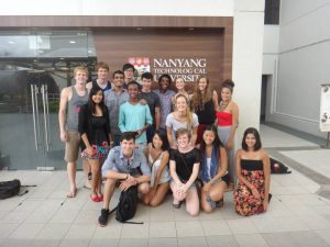 Max with classmates in front of Nanyang Technological University sign