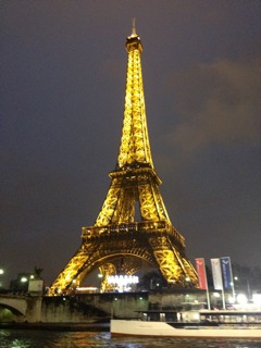 The Eiffel Tower at night, from a boat tour our first weekend.