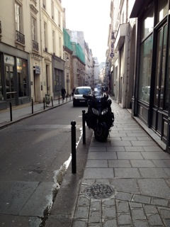 The street where I go to school. Notice the motorcycle parked on the sidewalk—and this one's relatively out of the way