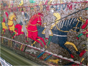 The mosaic, which depicts a medieval story that progresses throughout the mosaic.