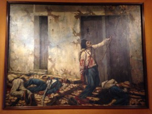 A painting of Juan Santamaría setting fire to the 'Mesón de Guerra' during the Second Battle of Rivas.