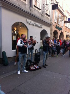 Street performers performing Mozart, right next to the house in which Mozart was born.