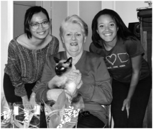 """""""Family Picture"""" (from left to right) roommate Kelly and host mom Brigitte holding the cat Faro"""